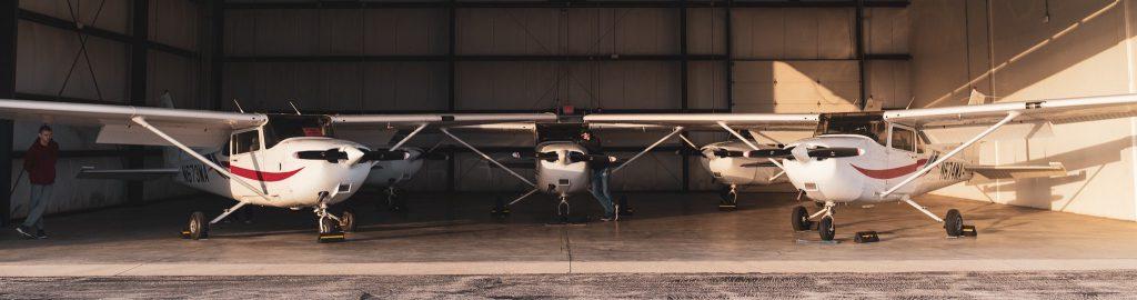 Five Cessna 172R parked inside Hangar 5 at Lewis University