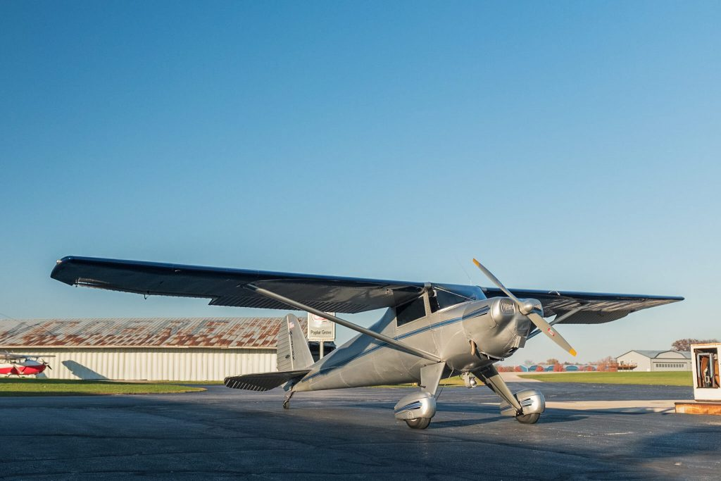 Silver Luscombe 8A (N1318K) owned by Jim Pratt parked outside fueling station at Poplar Grove Airport (C77) on clear day